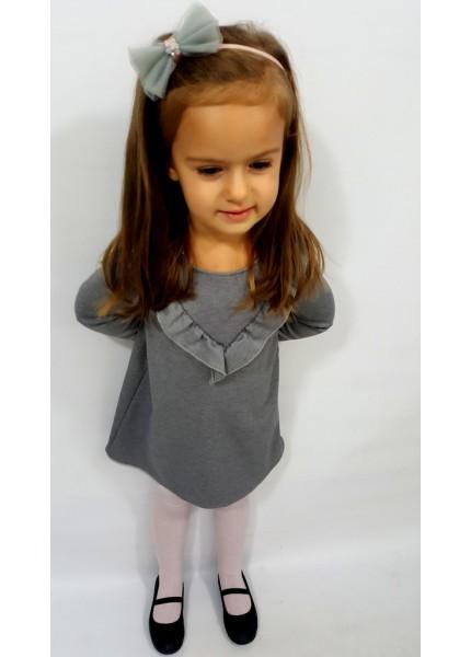 Dziecięca sukienka z falbnką w trójkąt